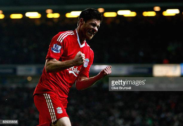 Xabi Alonso of Liverpool celebrates scoring the first goal during the Barclays Premier League match between Blackburn Rovers and Liverpool at Ewood...