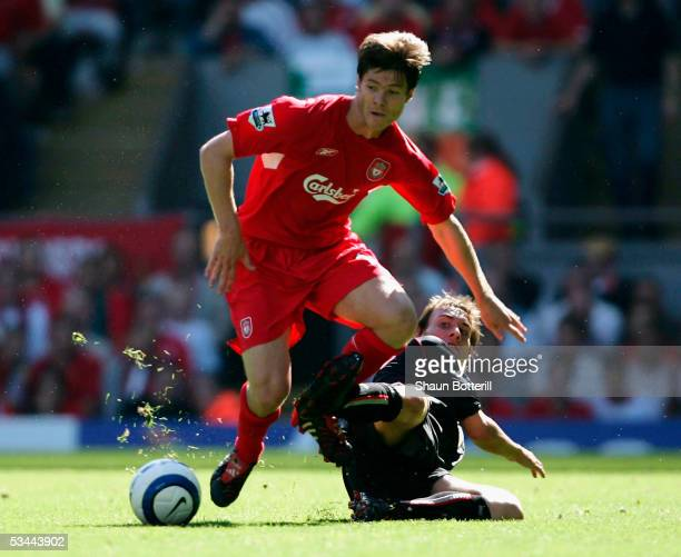 Xabi Alonso of Liverpool is tackled by Dean Whitehead of Sunderland during the Barclays Premiership match between Liverpool and Sunderland at Anfield...
