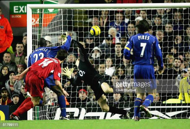 Xabi Alonso of Liverpool scores the first goal during the Barclays Premiership match between Liverpool and Arsenal at Anfield on November 28 2004 in...