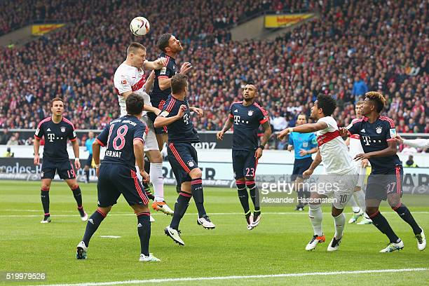Xabi Alonso of Muenchen battles for the ball with Toni Sunjic of Stuttgart during the Bundesliga match between VfB Stuttgart and FC Bayern Muenchen...