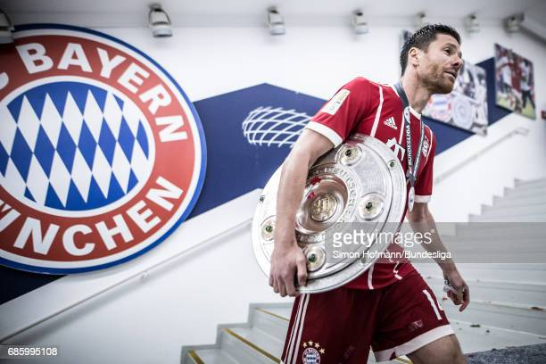 Xabi Alonso of Muenchen carries the trophy in the player's tunnel after the Bundesliga match between Bayern Muenchen and SC Freiburg at Allianz Arena...