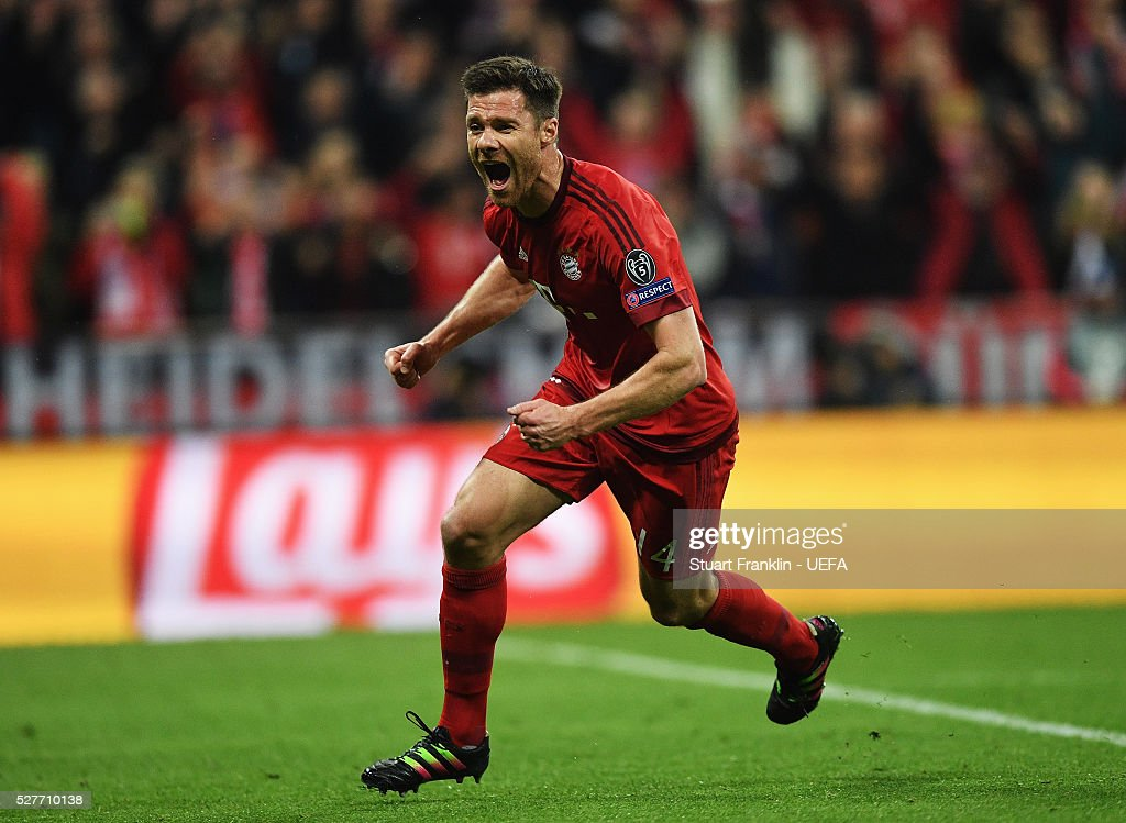 Xabi Alonso of Muenchen celebrates scoring his goal during the UEFA Champions League Semi Final second leg match between FC Bayern Muenchen and Club Atletico de Madrid at the Allianz Arena on May 03, 2016 in Munich, Bavaria.