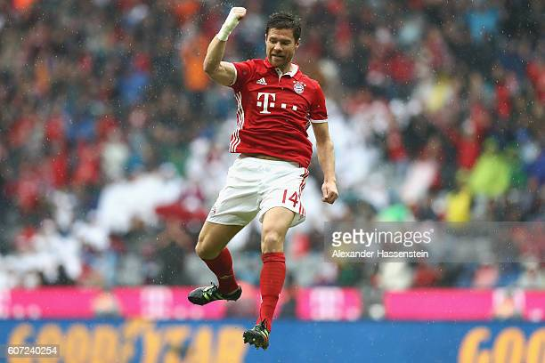 Xabi Alonso of Muenchen celebrates scoring the 2nd team goal during the Bundesliga match between Bayern Muenchen and FC Ingolstadt 04 at Allianz...