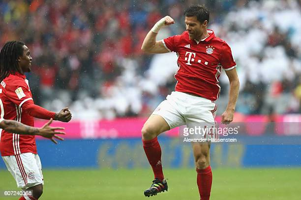Xabi Alonso of Muenchen celebrates scoring the 2nd team goal with his team mate Renato Sanches during the Bundesliga match between Bayern Muenchen...