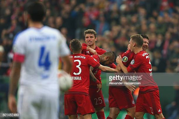 Xabi Alonso of Muenchen celebrates scoring the opening goal with his team mate Joshua Kimmich during the round of 16 DFB Cup match between FC Bayern...