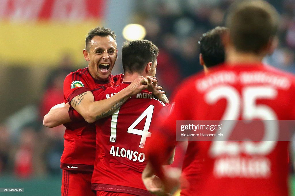 Xabi Alonso of Muenchen celebrates scoring the opening goal with his team mate Rafinha during the round of 16 DFB Cup match between FC Bayern...