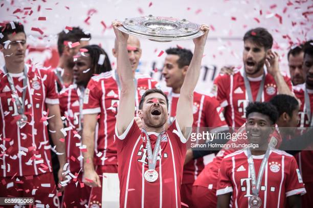 Xabi Alonso of Muenchen celebrates with the trophy after the Bundesliga match between Bayern Muenchen and SC Freiburg at Allianz Arena on May 20 2017...