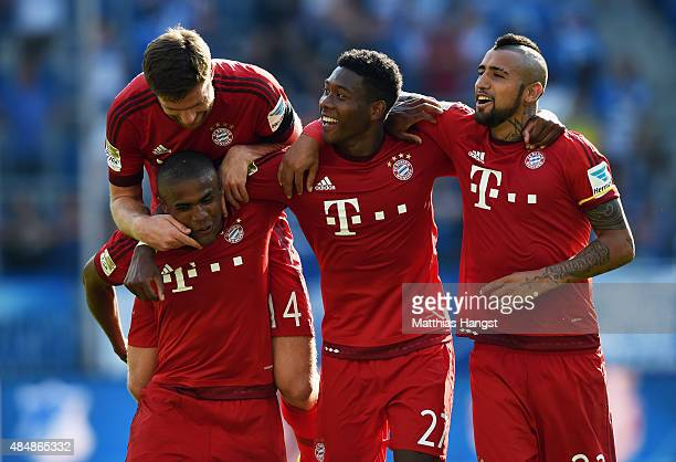 Xabi Alonso of Muenchen Douglas Costa of Muenchen David Alaba of Muenchen and Arturo Vidal of Muenchen celebrate after the Bundesliga match between...