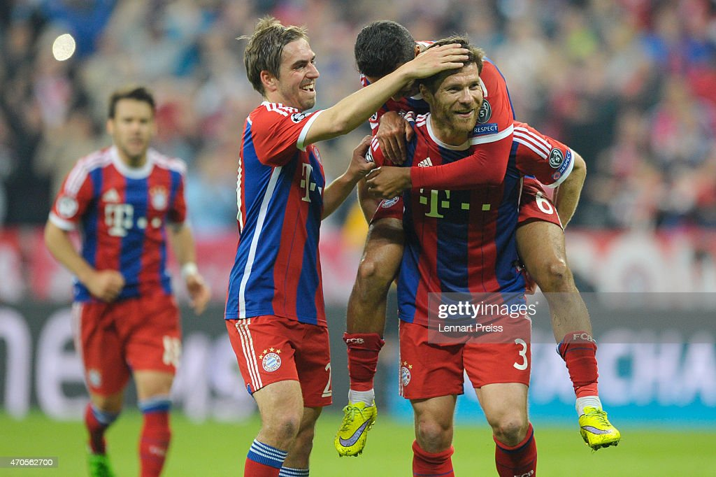 Xabi Alonso of Munich and his teammates celebrate their team's sixth goal during the UEFA Champions League quarter final second leg match between FC...