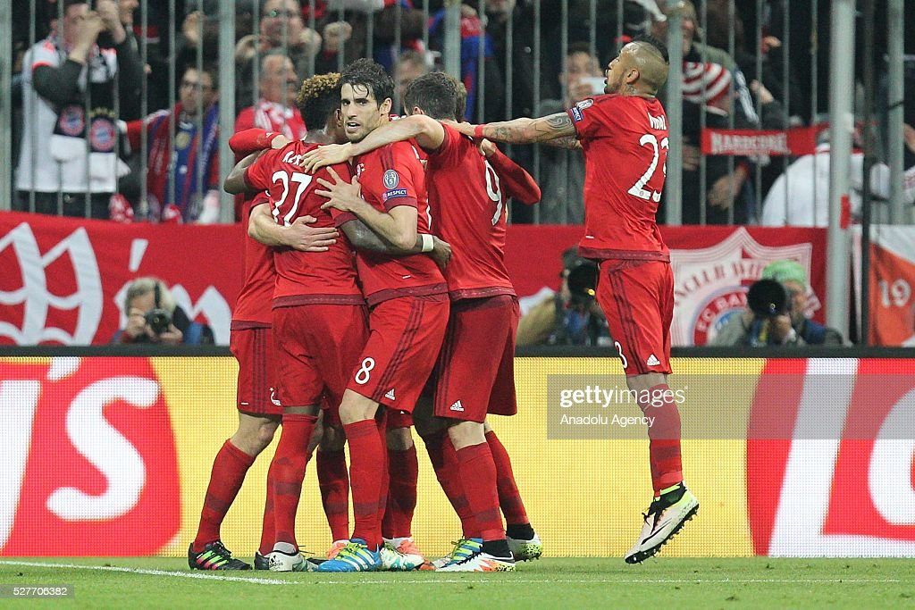Xabi Alonso of Munich celebrates with teammates after scoring a goal during the Champions League semifinal second leg soccer match between FC Bayern Munich and Atletico Madrid at the Allianz Arena on May 3, 2016, in Munich, Germany.
