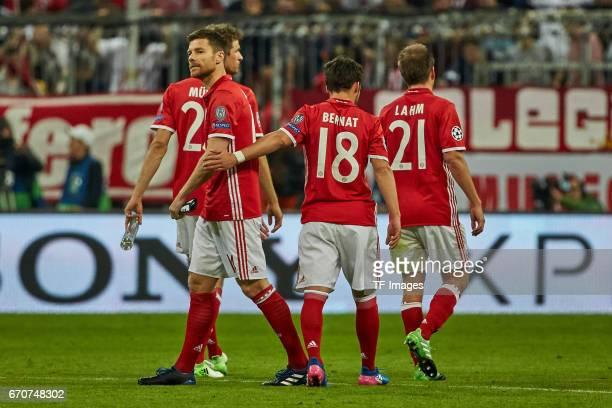 Xabi Alonso of Munich Juan Bernat of Munich and Philipp Lahm of Munich looks on during the UEFA Champions League Quarter Final first leg match...