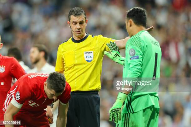 Xabi Alonso of Munich Referee Viktor Kassai and Goalkeeper Keylor Navas of Real Madrid looks on during the UEFA Champions League Quarter Final second...