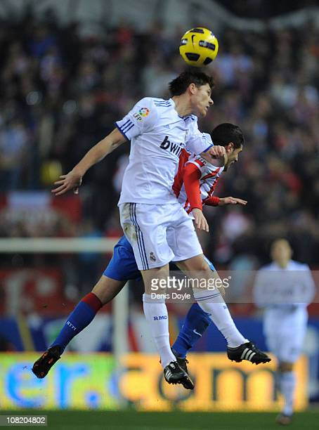 Xabi Alonso of Real Madrid goes for a high ball during the Copa del Rey quarter final second leg match between Atletico Madrid and Real Madrid at...