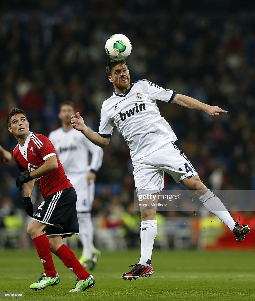 Xabi Alonso of Real Madrid heads the ball during the Copa del Rey round of 16 second leg match between Real Madrid and Celta de Vigo at Estadio Santiago Bernabeu on January 9, 2013 in Madrid, Spain.