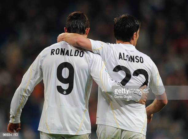 Xabi Alonso of Real Madrid is congratulated by Cristiano Ronaldo after he scored from the penalty spot during the La Liga match between Real Madrid...
