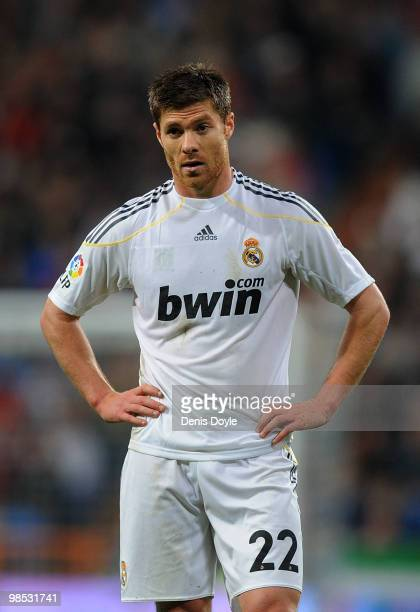 Xabi Alonso of Real Madrid pauses during the La Liga match between Real Madrid and Valencia at Estadio Santiago Bernabeu on April 18 2010 in Madrid...