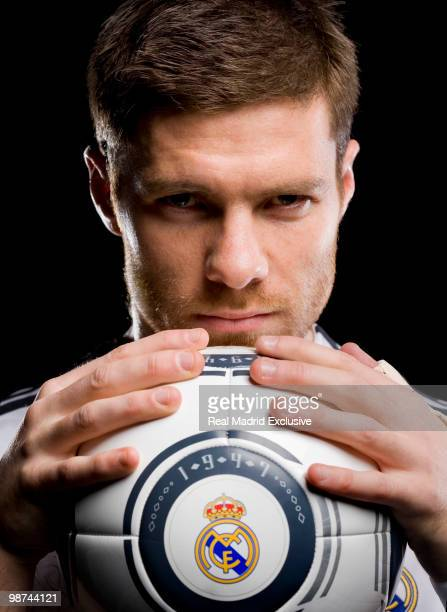 Xabi Alonso of Real Madrid poses during a photo session at the Bernabeu Stadium on November 26 2010 in Madrid Spain