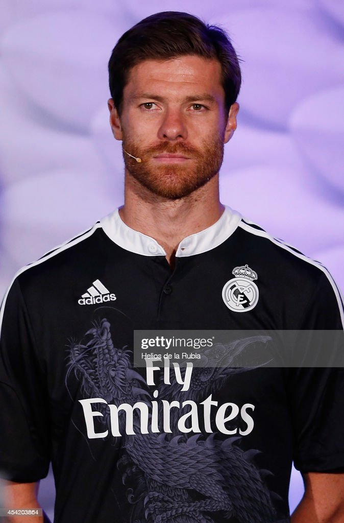 Xabi Alonso of Real Madrid poses during the adidas 3rd kit launch at Estadio Santiago Bernabeu on August 26, 2014 in Madrid, Spain.