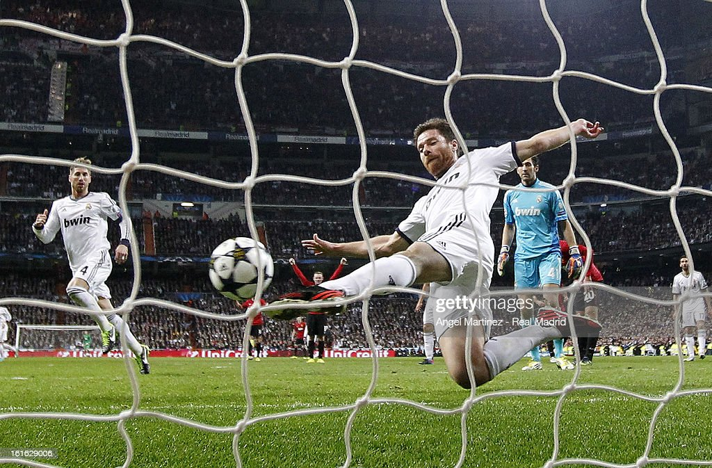 Xabi Alonso of Real Madrid saves a shot on the goal line during the UEFA Champions League Round of 16 first leg match between Real Madrid and Manchester United at Estadio Santiago Bernabeu on February 13, 2013 in Madrid, Spain.