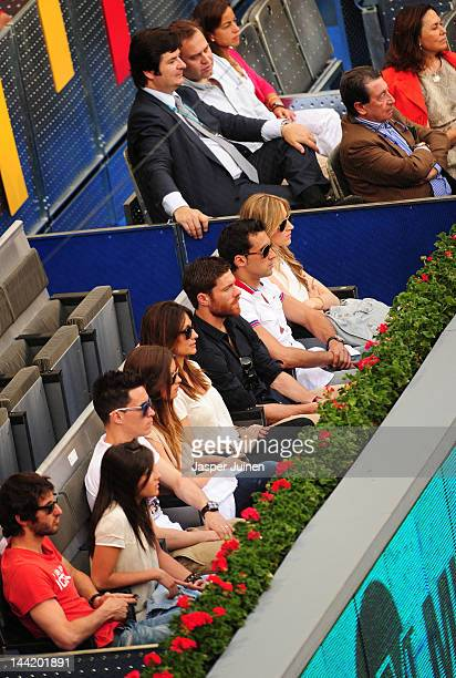Xabi Alonso of Real Madrid sits with his teammates Alvaro Arbeloa Jose Maria Callejon and Esteban Granero as they watch the quarter final match...