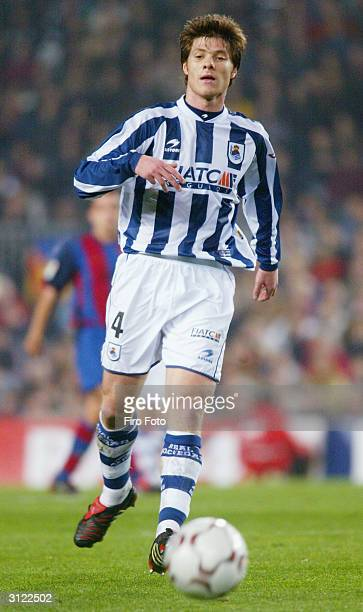Xabi Alonso of Real Sociedad in action during the Primera Liga match between Barcelona and Real Sociedad on March 21 2004 at the Nou Camp stadium in...