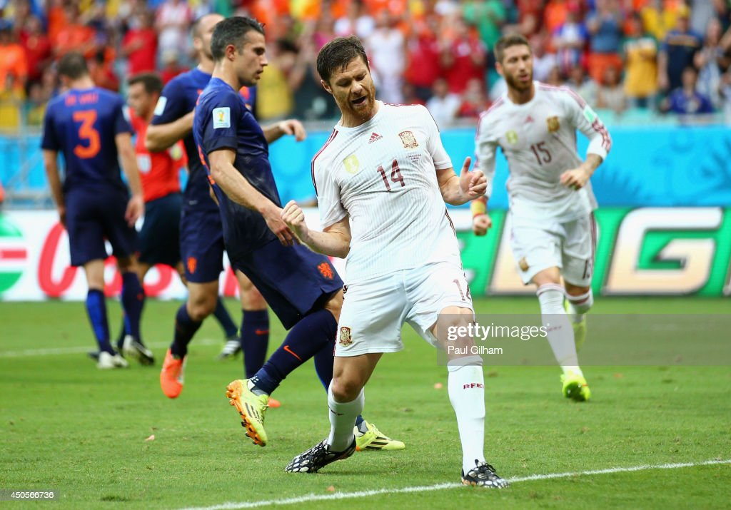 Xabi Alonso of Spain celebrates after scoring a goal on a penalty kick in the first half during the 2014 FIFA World Cup Brazil Group B match between...