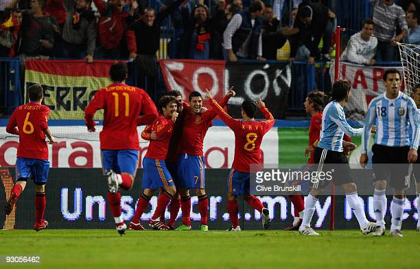 Xabi Alonso of Spain celebrates after scoring the first goal with David Villa during the friendly International football match Spain against...