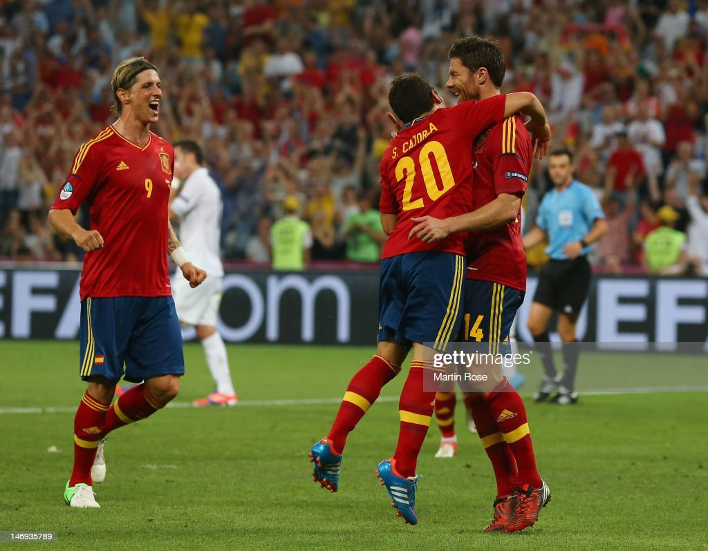 Xabi Alonso (R) of Spain celebrates after scoring the second goal with Santi Cazorla and Fernando Torres during the UEFA EURO 2012 quarter final match between Spain and France at Donbass Arena on June 23, 2012 in Donetsk, Ukraine.