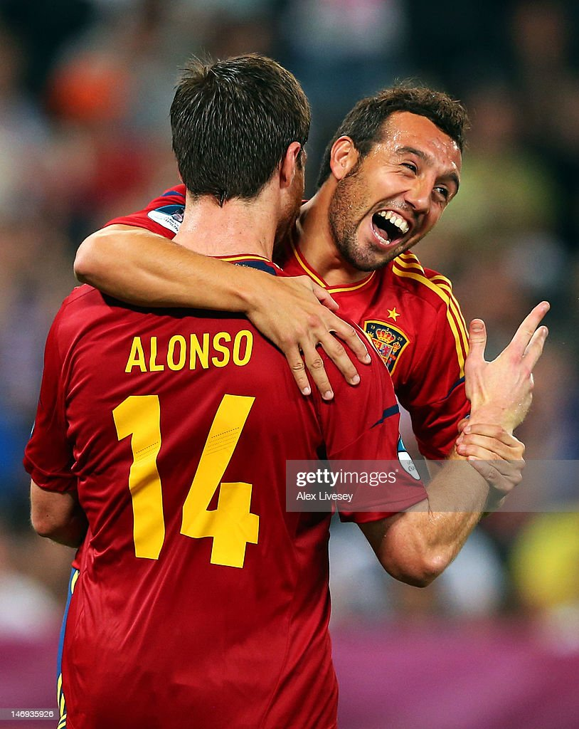 Xabi Alonso of Spain celebrates after scoring the second goal with Santi Cazorla during the UEFA EURO 2012 quarter final match between Spain and France at Donbass Arena on June 23, 2012 in Donetsk, Ukraine.