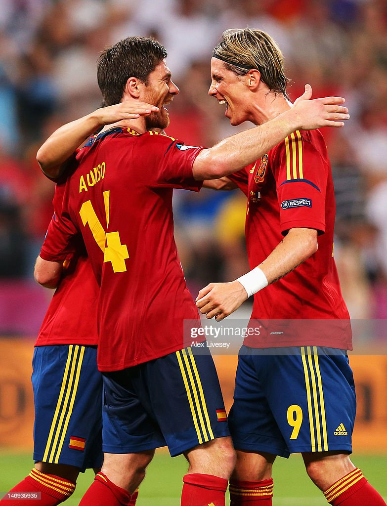 Xabi Alonso of Spain celebrates after scoring the second goal with Fernando Torres during the UEFA EURO 2012 quarter final match between Spain and France at Donbass Arena on June 23, 2012 in Donetsk, Ukraine.