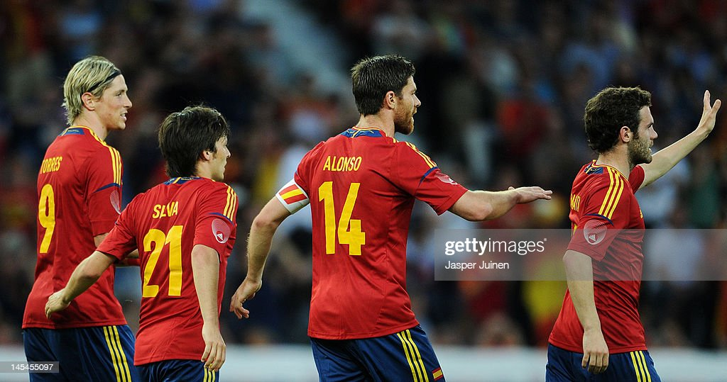 <a gi-track='captionPersonalityLinkClicked' href=/galleries/search?phrase=Xabi+Alonso&family=editorial&specificpeople=213833 ng-click='$event.stopPropagation()'>Xabi Alonso</a> (2nd R) of Spain celebrates scoring from the penalty spot with his teammates <a gi-track='captionPersonalityLinkClicked' href=/galleries/search?phrase=Juan+Mata&family=editorial&specificpeople=4784696 ng-click='$event.stopPropagation()'>Juan Mata</a> (R), <a gi-track='captionPersonalityLinkClicked' href=/galleries/search?phrase=David+Silva&family=editorial&specificpeople=675795 ng-click='$event.stopPropagation()'>David Silva</a> (2nd L) and <a gi-track='captionPersonalityLinkClicked' href=/galleries/search?phrase=Fernando+Torres&family=editorial&specificpeople=194755 ng-click='$event.stopPropagation()'>Fernando Torres</a> during the international friendly match between Spain and Korea Republic on May 30, 2012 in Bern, Switzerland.