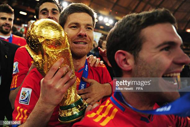 Xabi Alonso of Spain holds the World Cup after the 2010 FIFA World Cup South Africa Final match between Netherlands and Spain at Soccer City Stadium...