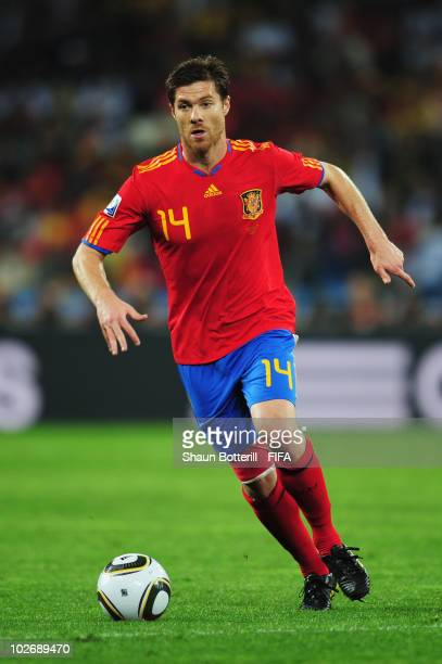 Xabi Alonso of Spain in action during the 2010 FIFA World Cup South Africa Semi Final match between Germany and Spain at Durban Stadium on July 7...