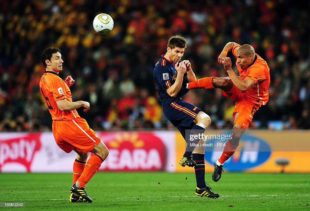 <a gi-track='captionPersonalityLinkClicked' href=/galleries/search?phrase=Xabi+Alonso&family=editorial&specificpeople=213833 ng-click='$event.stopPropagation()'>Xabi Alonso</a> of Spain (C) is fouled by Nigel De Jong of the Netherlands during the 2010 FIFA World Cup South Africa Final match between Netherlands and Spain at Soccer City Stadium on July 11, 2010 in Johannesburg, South Africa.