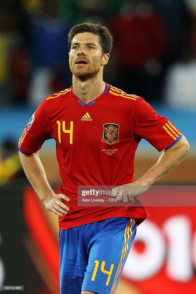 <a gi-track='captionPersonalityLinkClicked' href=/galleries/search?phrase=Xabi+Alonso&family=editorial&specificpeople=213833 ng-click='$event.stopPropagation()'>Xabi Alonso</a> of Spain looks dejected after their defeat in the 2010 FIFA World Cup South Africa Group H match between Spain and Switzerland at Durban Stadium on June 16, 2010 in Durban, South Africa.