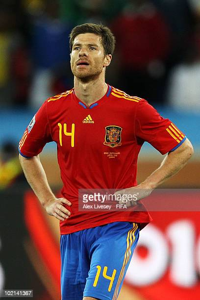 Xabi Alonso of Spain looks dejected after their defeat in the 2010 FIFA World Cup South Africa Group H match between Spain and Switzerland at Durban...