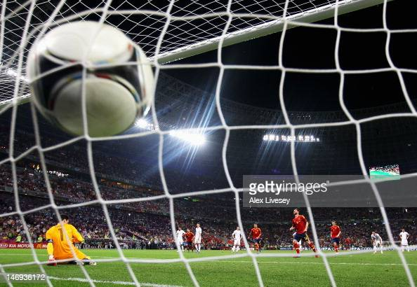 Xabi Alonso of Spain scores the second goal from the penalty spot during the UEFA EURO 2012 quarter final match between Spain and France at Donbass...