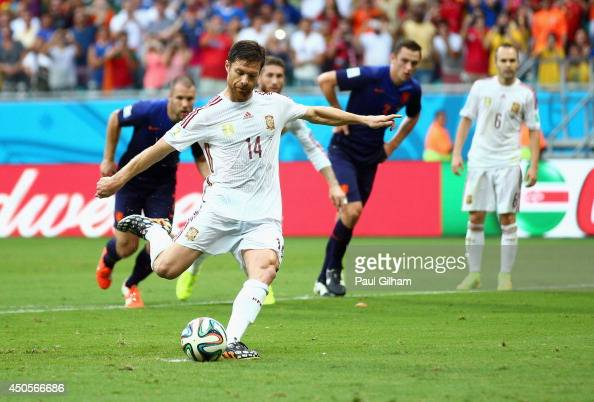 Xabi Alonso of Spain shoots and scores a goal on a penalty kick in the first half during the 2014 FIFA World Cup Brazil Group B match between Spain...