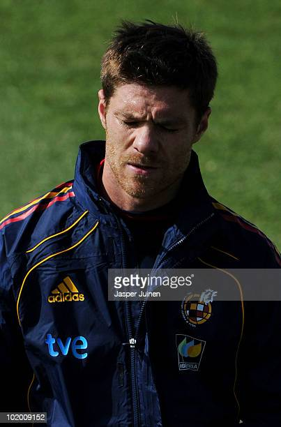 Xabi Alonso of Spain walks off the pitch after abandoning the training session on June 12 2010 in Potchefstroom South Africa