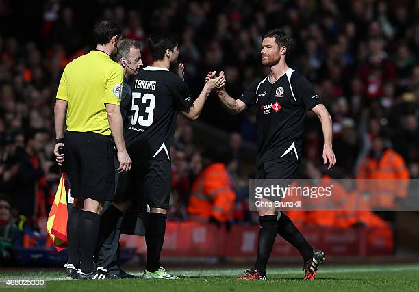 Xabi Alonso of the Gerrard XI is substituted during the Liverpool AllStar Charity match at Anfield on March 29 2015 in Liverpool England