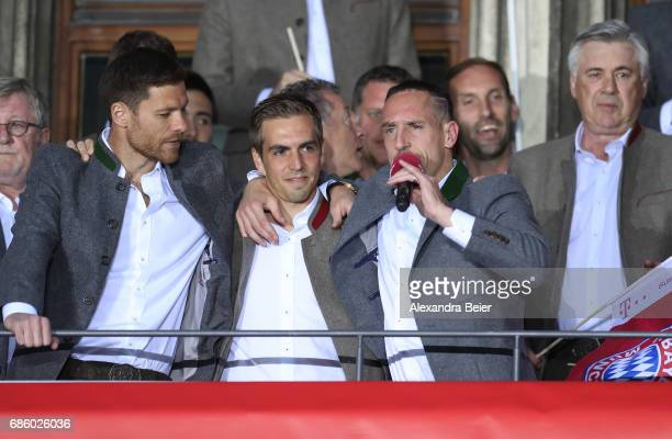 Xabi Alonso Philipp Lahm and Franck Ribery of Bayern Muenchen celebrate winning the 67th German Championship title on the town hall balcony at...