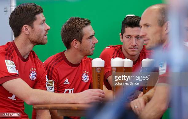 Xabi Alonso Philipp Lahm Robert Lewandowski and Arjen Robben of Bayern Muenchen attend the FC Bayern Muenchen Paulaner photo shoot at Bayern...