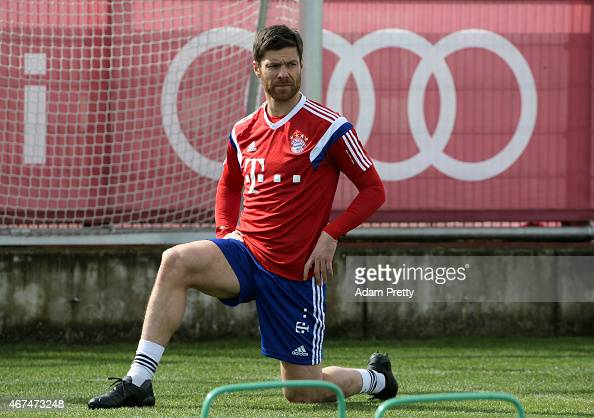 Xabi Alonso stretches during the FC Bayern training session at Bayern's training ground Saebener Strasse on March 25 2015 in Munich Germany