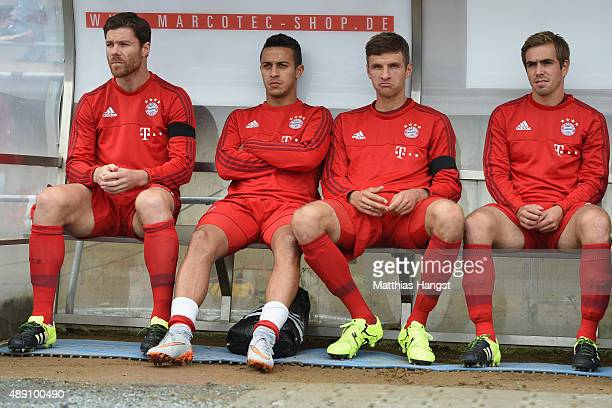 Xabi Alonso Thiago Thomas Mueller and Philipp Lahm of Muenchen take place on the bench for the Bundesliga match between SV Darmstadt 98 and FC Bayern...