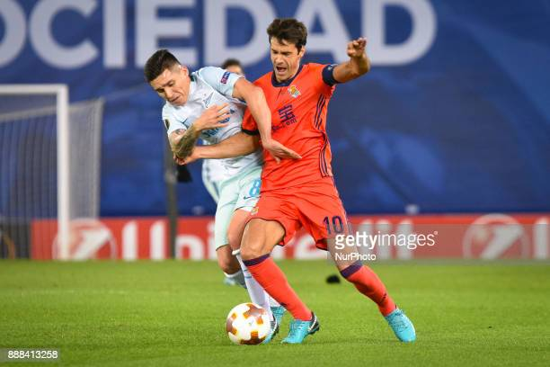 Xabi Prieto of Real Sociedad duels for the ball with Matias Kranevitter of Zenit during the UEFA Europa League Group L football match between Real...