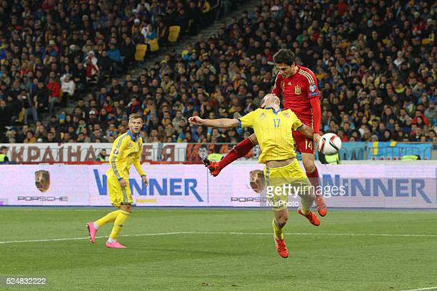 Xabier Etxeita of Spain national team vies with Artem Fedetskyi of Ukraine during the European Qualifiers 2016 match between Ukraine and Spain...