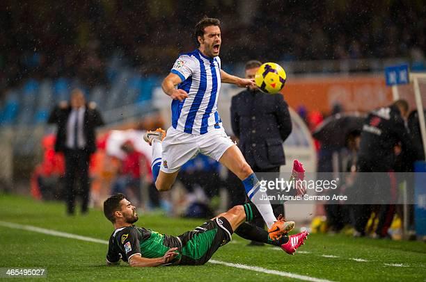 Xabier Prieto of Real Sociedad duels for the ball with Alberto Botian of Elche FC during the La Liga match between Real Sociedad de Futbol and Elche...