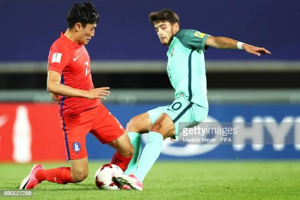 Xadas of Portugal challenges Lee Jinhyun of Korea Republic during the FIFA U20 World Cup Korea Republic 2017 Round of 16 match between Korea Republic...