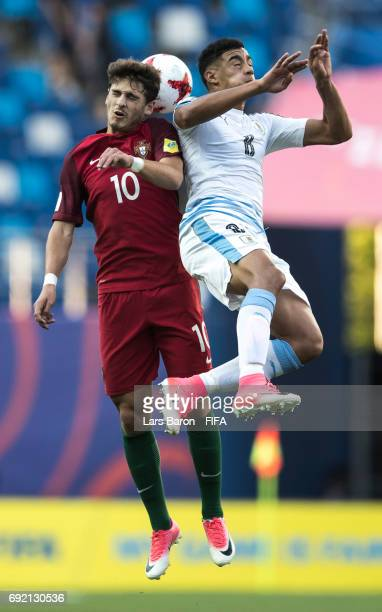 Xadas of Portugal goes up for a header with Carlos Benavidez of Uruguay during the FIFA U20 World Cup Korea Republic 2017 Quarter Final match between...