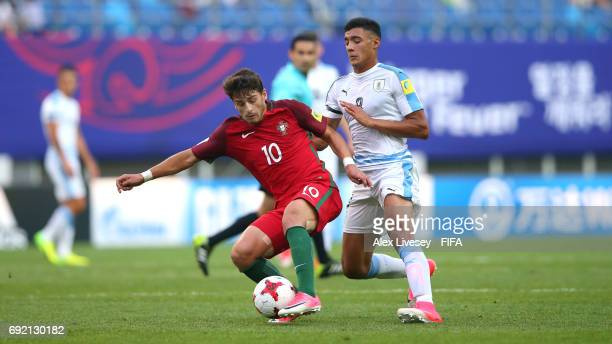 Xadas of Portugal holds off a challenge from Carlos Benavidez of Uruguay during the FIFA U20 World Cup Korea Republic 2017 Quarter Final match...